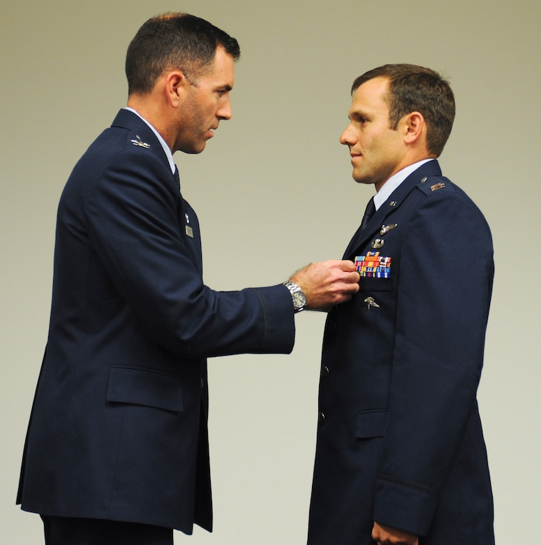 U.S. Air Force Capt. Kevin Epstein, 48th Rescue Squadron combat rescue officer, receives a Bronze Star Medal with valor from Col. Sean Choquette, 563rd Rescue Group commander, at Davis-Monthan Air Force Base, Ariz., June 2, 2014. The Bronze Star Medal is the fourth highest individual military award and the ninth highest by order of precedence in the U.S. Military. It may be awarded for acts of heroism, merit, or meritorious service in a combat zone. (U.S. Air Force photo by Senior Airman Sivan Veazie/Released)
