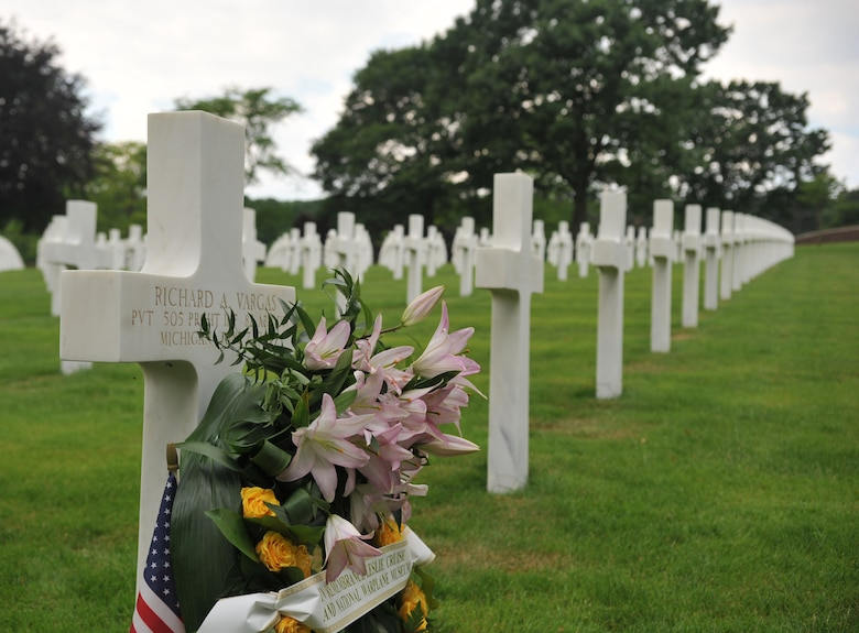 A wreath lays in front of Pvt. Richard Vargas' grave after a ceremony that took place at Lorraine American National Cemetery and Memorial, St. Avold, France, June 2, 2014. Seventy years ago on June 7, 1944 Pvt. Richard Vargas saved Leslie Cruise's life, a World War II veteran, during the invasion of Normandy. Cruise went to France several times prior to this visit looking for his friend's grave in order to say thank you. (U.S. Air Force photo/Senior Airman Hailey Haux)