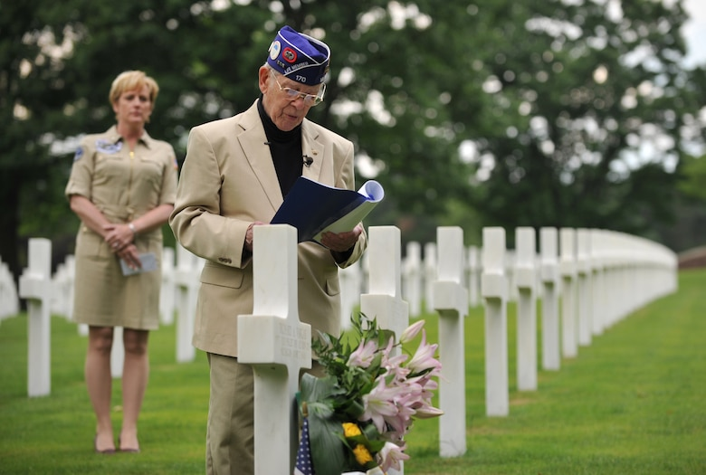 Leslie Cruise, a World War II veteran, reads the paratroopers creed during a wreath laying ceremony at Lorraine American National Cemetery and Memorial, St. Avold, France, June 2, 2014. Seventy years ago on June 7, 1944 Pvt. Richard Vargas saved Cruise's life during the invasion of Normandy. Cruise went to France several times prior to this visit looking for his friend's grave in order to say thank you. (U.S. Air Force photo/Senior Airman Hailey Haux)