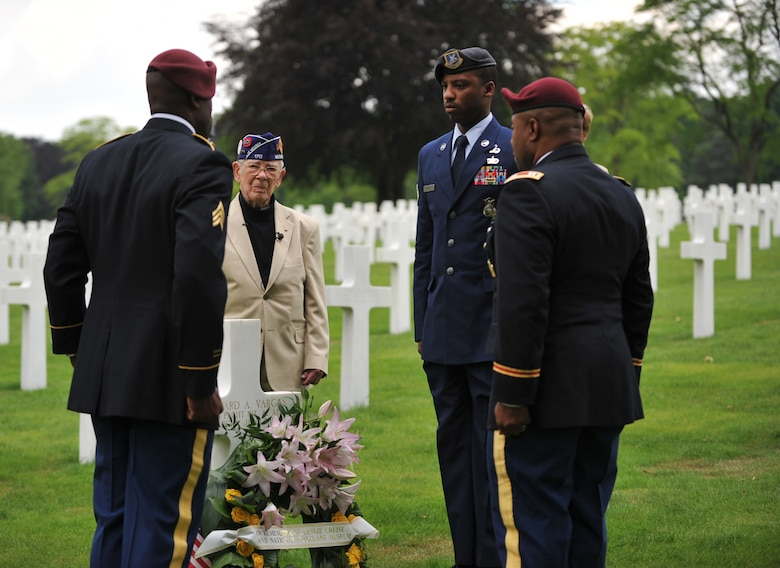 Leslie Cruise, a World War II veteran, and members from the 5th Quartermaster Theater Aerial Delivery Company, 435th Air Ground Operations Wing's Contingency Response Group and 21st Theater Sustainment Command lay down a wreath in honor of Pvt. Richard Vargas at Lorraine American National Cemetery and Memorial, St. Avold, France, June 2, 2014. Seventy years ago on June 7, 1944 Pvt. Richard Vargas saved Cruise's life during the invasion of Normandy. Cruise went to France several times prior to this visit looking for his friend's grave in order to say thank you. (U.S. Air Force photo/Senior Airman Hailey Haux)