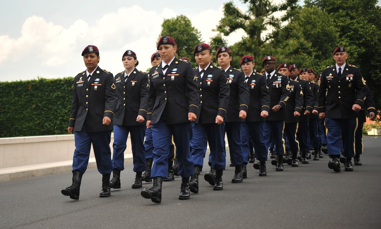 Members from the 5th Quartermaster Theater Aerial Delivery Company, 435th Air Ground Operations Wing's Contingency Response Group and 21st Theater Sustainment Command march toward the grave of Pvt. Richard Vargas during a wreath laying ceremony at Lorraine American National Cemetery and Memorial, St. Avold, France, June 2, 2014. Vargas saved the life of Leslie Cruise, a World War II veteran. Cruise went to France several times prior to this visit looking for his friend's grave in order to say thank you. (U.S. Air Force photo/Senior Airman Hailey Haux)