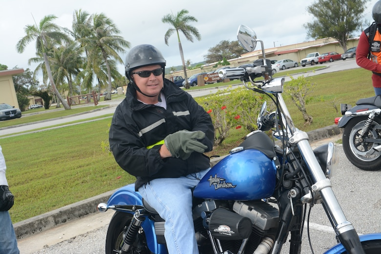 Col. Thomas Livingston, 36th Contingency Response Group Commander, prepares to go on a motorcycle ride on Andersen Air Force Base Guam, May 29, 2014. The 36th CRG hosted a bike ride on Andersen to raise motorcycle safety awareness amongst riders on base. (U.S. Air Force photo by Airman 1st Class Adarius Petty/Released)