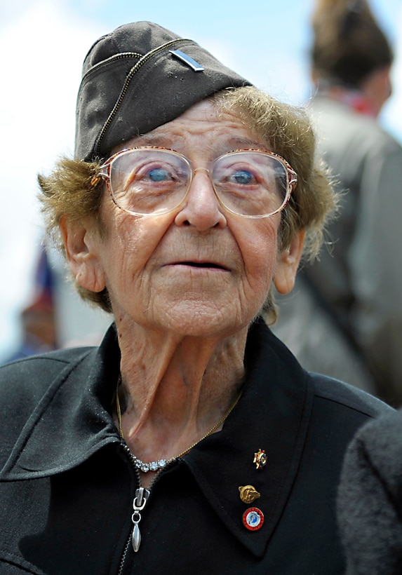 Ellan Levitsky-Orkin, who served as a U.S. Army nurse in Normandy during World War II, listens to a speech by U.S. Army paratrooper during a ceremony honoring the service of U.S. Army nurses during World War II, in Bolleville, France, June 4, 2014.