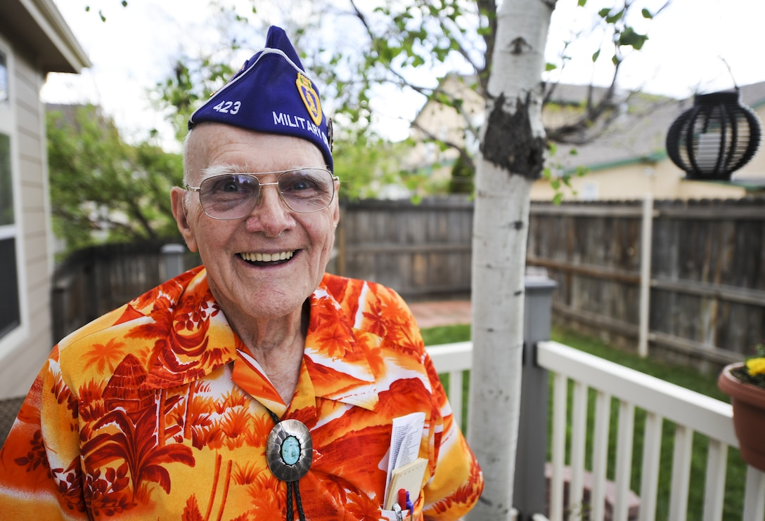 Wayne Field stands in his backyard wearing his Military Order of the Purple Heart Association flight cap May 28, 2014, in Colorado Springs, Colo. Field was a mechanized reconnaissance veteran who fought in the Battle of the Bulge and was wounded shortly after in 1945. After being discharged from the Army, Field started the first post-World War II Civil Air Patrol units in Binghamton, New York, and served in the CAP for more than 30 years contributing to the success of CAP today. Field received the Congressional Gold Medal, the highest civilian award for his service during World War II as a member of the CAP. (Courtesy photo)