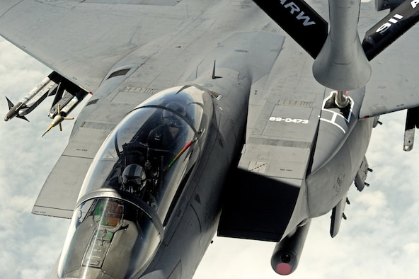 An F-15E Strike Eagle aircraft piloted by Col. Jeannie Leavitt receives fuel from a KC-135R Stratotanker during her final flight, May 29, 2014, over North Carolina. During her career as the first female fighter pilot, Leavitt recorded more than 2,600 flying hours in the F-15E. Leavitt is the 4th Fighter Wing commander. (U.S. Air Force photo/Senior Airman John Nieves Camacho)
