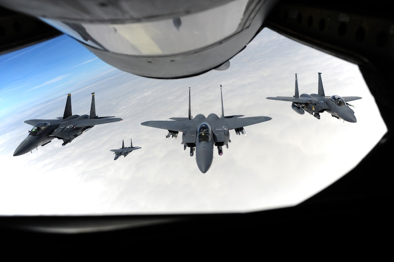Aircrew members assigned to the 4th Fighter Wing accompany Col. Jeannie Leavitt (middle) on her final flight, May 29, 2014, over North Carolina. Leavitt will depart Seymour Johnson Air Force Base, N.C., for an assignment to the Pentagon as the principle military assistant to the Secretary of Defense. Leavitt is the 4th FW commander. (U.S. Air Force photo/Senior Airman John Nieves Camacho)