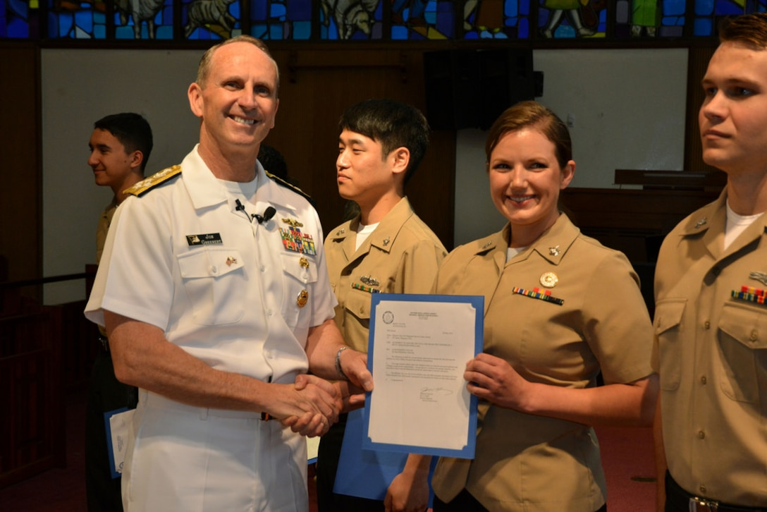 Chief of Naval Operations Adm. Jonathan Greenert frocks Information Systems Technician 2nd Class Margaret Steck before an all hands call for Seoul-based sailors and Navy families on U.S. Army Garrison Yongsan, May 30.