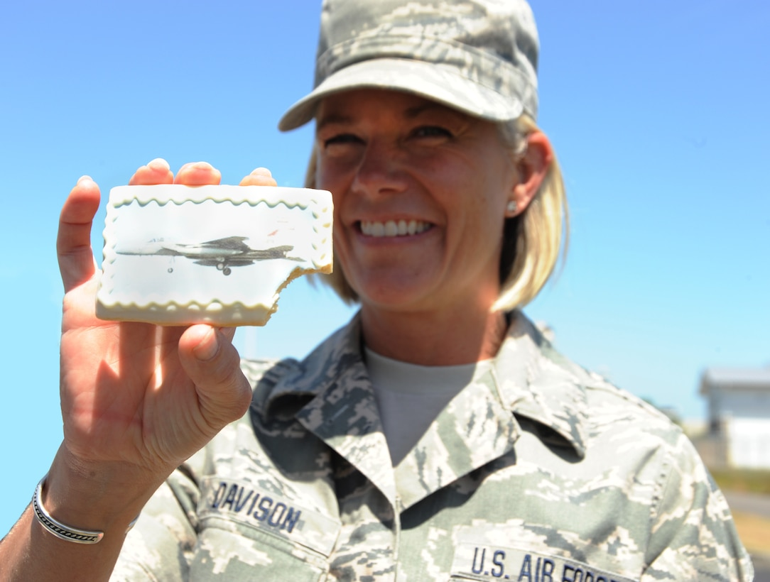 Master Sgt. Shelly Davison, assigned to the 142nd Fighter Wing Public Affairs Office, shows off a cookie after the official opening of the new Portland Air National Guard Base Service Station, June 5, 2014. (Air National Guard photo by Tech. Sgt. John Hughel, 142nd Fighter Wing Public Affairs/Released)