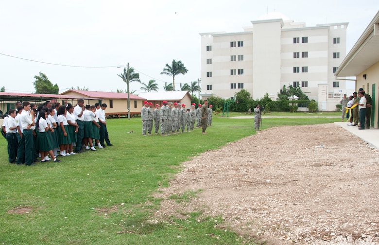 Edward P. Yorke students and teachers and U.S. and Belizean military members listen to remarks by Rodrick Cardinez, E.P. Yorke principal, during the ribbon cutting ceremony June 4, 2014, at the school in Belize City, Belize. The school's 1,372 square foot, two-classroom addition is one of five New Horizons projects in the country. New Horizons is an annual multinational exercise that provides training opportunities in civil engineering and medical care. (U.S. Air Force photo by Tech. Sgt. Kali L. Gradishar/Released)