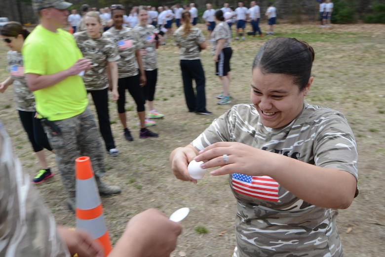 Staff Sgt. Selva Cabrera with the 103rd Force Support Squadron carefully transfers an uncooked egg onto her teammate's spoon during the second annual Yankee Warrior Day at Bradley Air National Guard Base, East Granby, Conn., May 3, 2014. The event included various team challenges to promote esprit de corps and physical fitness. (U.S. Air National Guard photo by Tech. Sgt. Joshua Mead)
