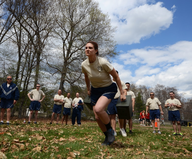 Airman First Class Amy Dziewaltowski, a logistics planner from the 103rd Logistics Readiness Squadron, takes off as fast as she can during the ammo-can run at the second annual Yankee Warrior Day at Bradley Air National Guard Base,  East Granby, Conn., May 3, 2014. (U.S. Air National Guard photo by Tech. Sgt. Joshua Mead)