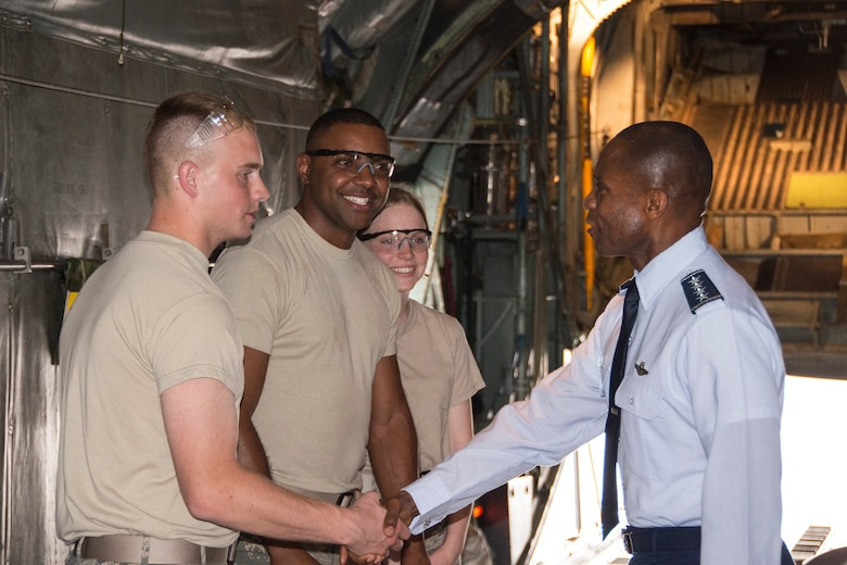 Gen. Darren McDew (right) greets Airman 1st Class Carlos Pires, Airman 1st Class William Shopey and Airman 1st Class Bailee Graveline, all non-destructive inspectors with the 103rd Airlift Wing, during his visit to Bradley Air National Guard Base, East Granby, Conn., May 27, 2014. Gen. McDew is the newly appointed commander of the Air Force's Air Mobility Command. His visit to the 103rd Airlift Wing provided an opportunity for Gen. McDew to witness the current operations that the Airmen manage during the unit's conversion to the C-130H aircraft. (U.S. Air National Guard photo by Master Sgt. Erin McNamara)