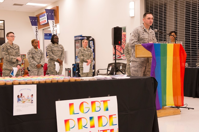 U.S. Air Force Maj. Mickey Jordan, 354th Communications Squadron commander, speaks during a Lesbian, Gay, Bisexual and Transgender Pride Month kick-off event June 2, 2014, Eielson Air Force Base, Alaska. Jordan gave opening remarks at the ceremony, reflecting how monumental celebrating LGBT Pride Month was to the wing. (U.S. Air Force photo by Senior Airman Joshua Turner/Released)