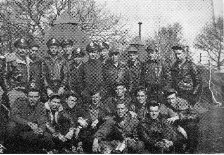 "P-47 pilots of the 404th Fighter Squadron gather for a picture in the spring of 1944.  Kneeling, second from the left is 2nd Lt. Joseph E. LaRochelle, who became the 371st Fighter Group's first pilot shot down and captured by the enemy when he bailed out of his flak-stricken P-47 overwater just off Granville, Normandy, on the afternoon of June 6, 1944.   Standing in the back row, sixth from the right, is Harry W. ""Pop"" Strahlendorf, who flew both missions that day, quoted in this article.  (Courtesy ""The 371st Fighter Group in the E.T.O."" via 406FS P-47 Pilot Francis E. Madore)"