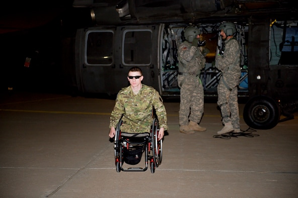Retired U.S. Army Sgt. Brendan Marrocco, arrives at an undisclosed location in Southwest Asia May 28, 2014 as a part of Operation Proper Exit, which has enabled him and five other wounded warriors the opportunity to obtain closure and to aid in their recoveries from injuries, internal and external, sustained on the battlefield by traveling to Afghanistan. Marrocco was welcomed by 386th Air Expeditionary Wing leadership and Tech. Sgt. Sarah Gann, 386th AEW protocol office. He is from Staten Island, New York and was injured in Baaji, Iraq, April 12, 2009.  He sustained injuries to his left eye and carotid artery and is a quadruple amputee. He is continuing his rehabilitating process at Walter Reed National Military Medical Center from a double arm transplant. (U.S. Air Force photo by Staff Sgt. Jeremy Bowcock)