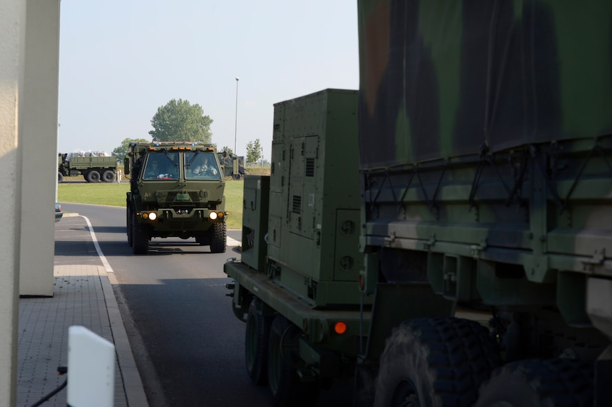 A 606th Air Control Squadron convoy departs Spangdahlem Air Base, Germany, June 2, 2014, to U.S. Air Force Aviation Detachment, Poland, for a planned aviation rotation. The 606th ACS will be supporting the Av-Det as well as participating in exercise Baltic Operations 2014. (U.S. Air Force photo by Staff Sgt. Christopher Ruano/Released)