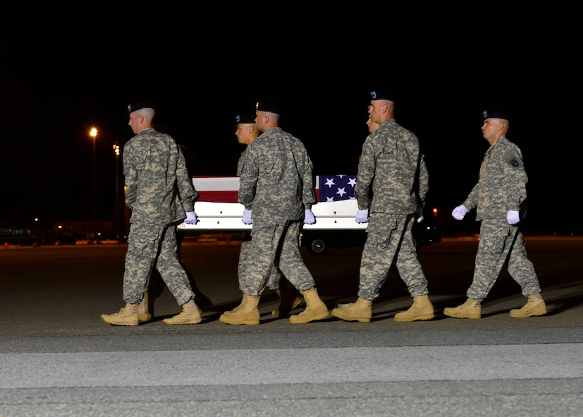 A U.S. Army carry team transfers the remains of Spc. Matthew H. Walker of Hillsboro, Mo., during a dignified transfer June 7, 2014, at Dover Air Force Base, Del., Walker was assigned to 1st Battalion, 502nd Infantry Regiment, 2nd Brigade Combat Team, 101st Airborne Division, Fort Campbell, Ky. (U.S. Air Force photo/Airman 1st Class William Johnson)