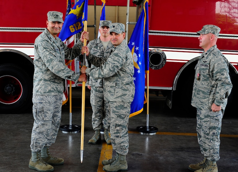 U. S. Air Force Lt. Col. Sergio J. Vega, Jr. assumes command of the 612th Air Base Squadron at Soto Cano Air Base, Honduras by accepting the guidon from U. S. Air Force Col. Jonathan R. VanNoord, the 612th Theater Operations Group commander, June 5, 2014. Vega assumed command from outgoing commander U. S. Air Force Lt. Col. Ray P. Matherne.  The 612th Air Base Squadron provides air base support to Joint Task Force-Bravo and 12th Air Force including air traffic control, logistics, base civil engineering, fire department, airfield operations and personnel functions.  In addition, the squadron maintains Soto Cano Air Base as the United States' only strategic gateway to Central America for United States Southern Command.  (Photo by Martin Chahin)