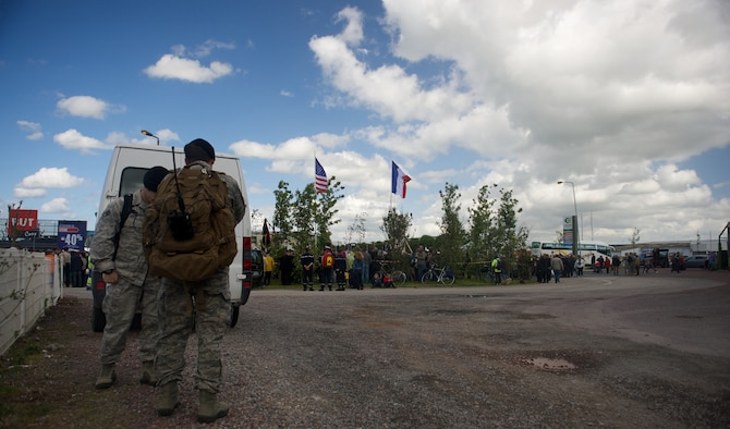 Tech. Sgt. Zachary Jacobs, front, and Senior Airman Jason Hoff coordinate a flyover behind the scenes of a 70th D-Day anniversary wreath laying ceremony, June 4, 2014, in Carentan, France. Jacobs and Hoff are joint terminal attack controllers with the 116th Air Support Operations Squadron, Washington. TACPs deploy with Soldiers to provide air support for operations on the ground. (U.S. Air Force photo/Senior Airman Alexander W. Riedel)