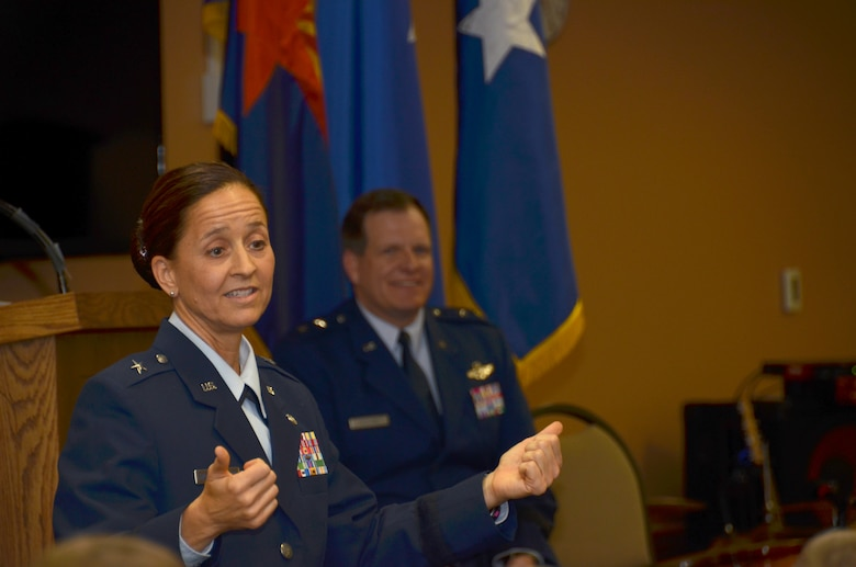 "U.S. Air Force Brig. Gen. Kerry L. Muehlenbeck, Arizona Army and Air Guard Joint Operations officer,  laughs with the audience during her promotion ceremony June 7, 2014 at the 161st Air Refueling Wing, Phoenix. ""The military is a big part of me – but it's not all of me. I've tried to balance all aspects of my life over the years,"" said Muehlenbeck. (U.S. Air National Guard photo by Senior Airman Rashaunda Williams/Released)"