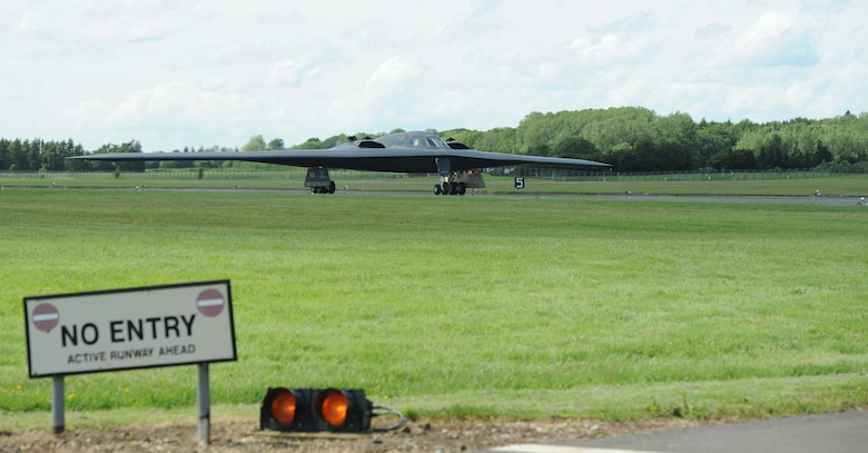 "The ""Spirit of Indiana,"" a B-2 Spirit from Whiteman Air Force Base, Mo., taxis down the runway at RAF Fairford, England, June 8, 2014. The B-2 Spirit is a multi-role bomber capable of delivering both conventional and nuclear munitions. (U.S. Air Force photo by Staff Sgt. Nick Wilson/Released)"