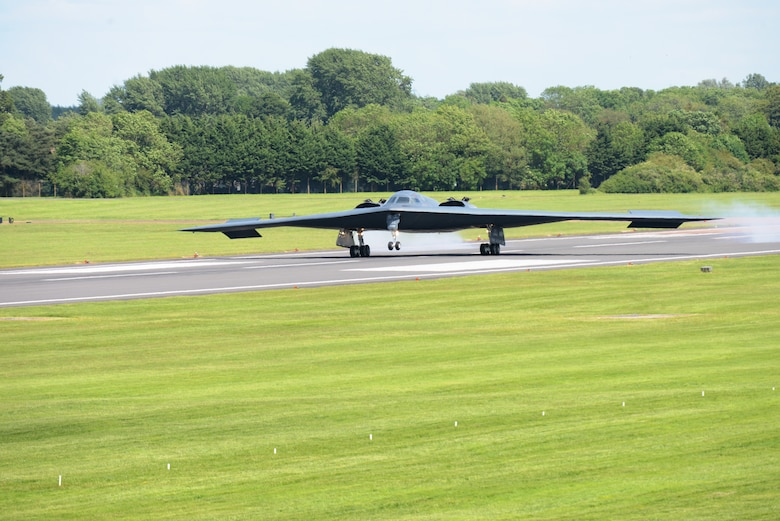 "A B-2 Spirit from the 509th Bomb Wing, Whiteman Air Force Base, Mo., lands on the runway at RAF Fairford, England, June 8, 2014. The B-2's low-observable, or ""stealth,"" characteristics give it the unique ability to penetrate an enemy's most sophisticated defenses and threaten its most valued, and heavily defended, targets. (U.S. Air Force photo by Tech. Sgt. Chrissy Best/Released)"