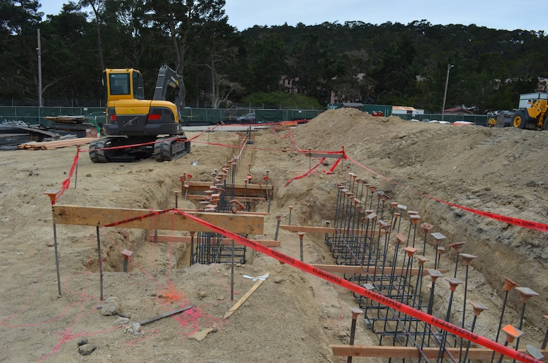 The construction site for the new dining facility at the Presidio of Monterey located in Monterey, Calif., May 8, 2014. The U.S. Army Corps of Engineers Sacramento District broke ground on the new dining facility March 17, 2014, that is designed to feed up to 1300 personnel over a 90 minute period. The facility is one of several major projects at the Presidio of Monterey managed by the Corps and incorporates the latest energy and water conservation technologies in order to operate more efficiently and in a sustainable, environmentally friendly manner.  Read more on the dining facility here: http://bit.ly/presidiodfac. (U.S. Army photo by Capt. Michael N. Meyer/Released)