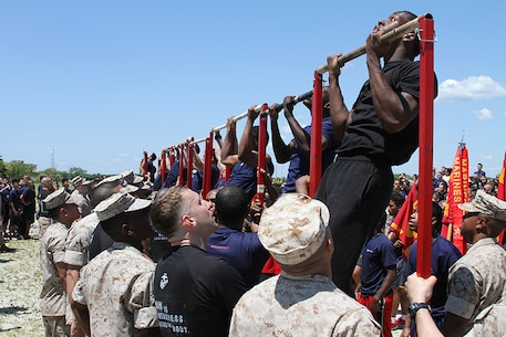 Poolees from each recruiting substation compete in a pull-up competition at the annual Sergeant Major's Cup field meet at Jones Beach in Wantagh, N.Y., June 7.
