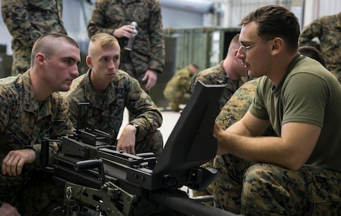 Lance Cpl. Jose A. Vivaldi, right, explains the cycle of operations for the MK19 40 mm automatic grenade launcher to Lance Cpl. Ryan Haylett, center, and Cpl. Brandon C. Perrine June 5 on Camp Mujuk, South Korea. The U.S. Marines familiarized themselves with the crew served weapon to enhance safety on ranges where they will train Republic of Korea Marines on the weapons employment as part of Korean Marine Exchange Program 14-8. KMEP 14-8 is one iteration in a series of continuous combined training exercises designed to enhance the ROK-U.S. alliance, promote stability on the Korean Peninsula, and strengthen ROK-U.S. military capabilities and interoperability. Vivaldi is a military policeman and range safety officer with 3rd Law Enforcement Battalion, III Marine Expeditionary Force Headquarters Group, III MEF. Haylett and Perrine are military policeman with 4th LE Bn., Force Headquarters Group, Marine Forces Reserve. (U.S. Marine Corps photo by Lance Cpl. Drew Tech/Released)