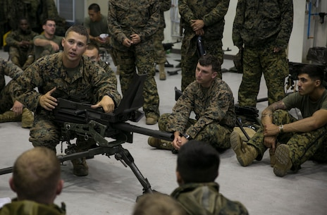 Staff Sgt. Eric J. Ellenberger, left, teaches the fundamentals of the MK19 40 mm automatic grenade launcher June 5 on Camp Mujuk, South Korea. The U.S. Marines familiarized themselves with the crew served weapon to enhance safety on ranges where they will train Republic of Korea Marines on the weapons employment as part of Korean Marine Exchange Program 14-8. KMEP 14-8 is one iteration in a series of continuous combined training exercises designed to enhance the ROK-U.S. alliance, promote stability on the Korean Peninsula, and strengthen ROK-U.S. military capabilities and interoperability. Ellenberger is a military policeman with 3rd Law Enforcement Battalion, III Marine Expeditionary Force Headquarters Group, III MEF. (U.S. Marine Corps photo by Lance Cpl. Drew Tech/Released)