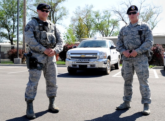 Master Sgt. Jonathan Krueger and Tech. Sgt. Jeremy Oates, 366th Security Forces Squadron flight chiefs, pose for a photo outside the 366th SFS, May 22, 2014, at Mountain Home Air Force Base, Idaho. On May 6th the two defenders responded to the scene of an unresponsive individual, resulting in the collaboration of base agencies and a life saved. (U.S. Air Force photo by Senior Airman Caitlin Guinazu/ RELEASED)