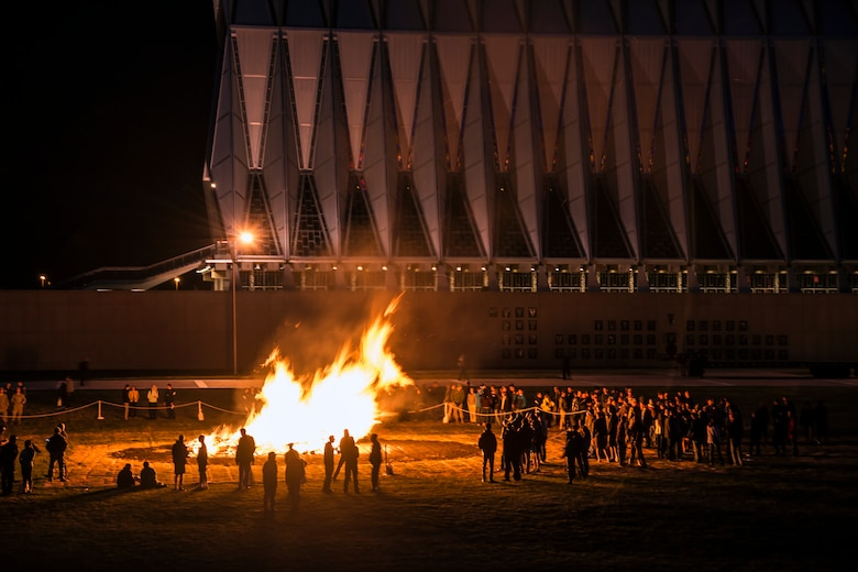 Academy cadets and staff members gather around a bonfire in observance of sexual assault awareness month for the 'Take Back the Night' event April 17. (U.S. Air Force Photo/Liz Copan)