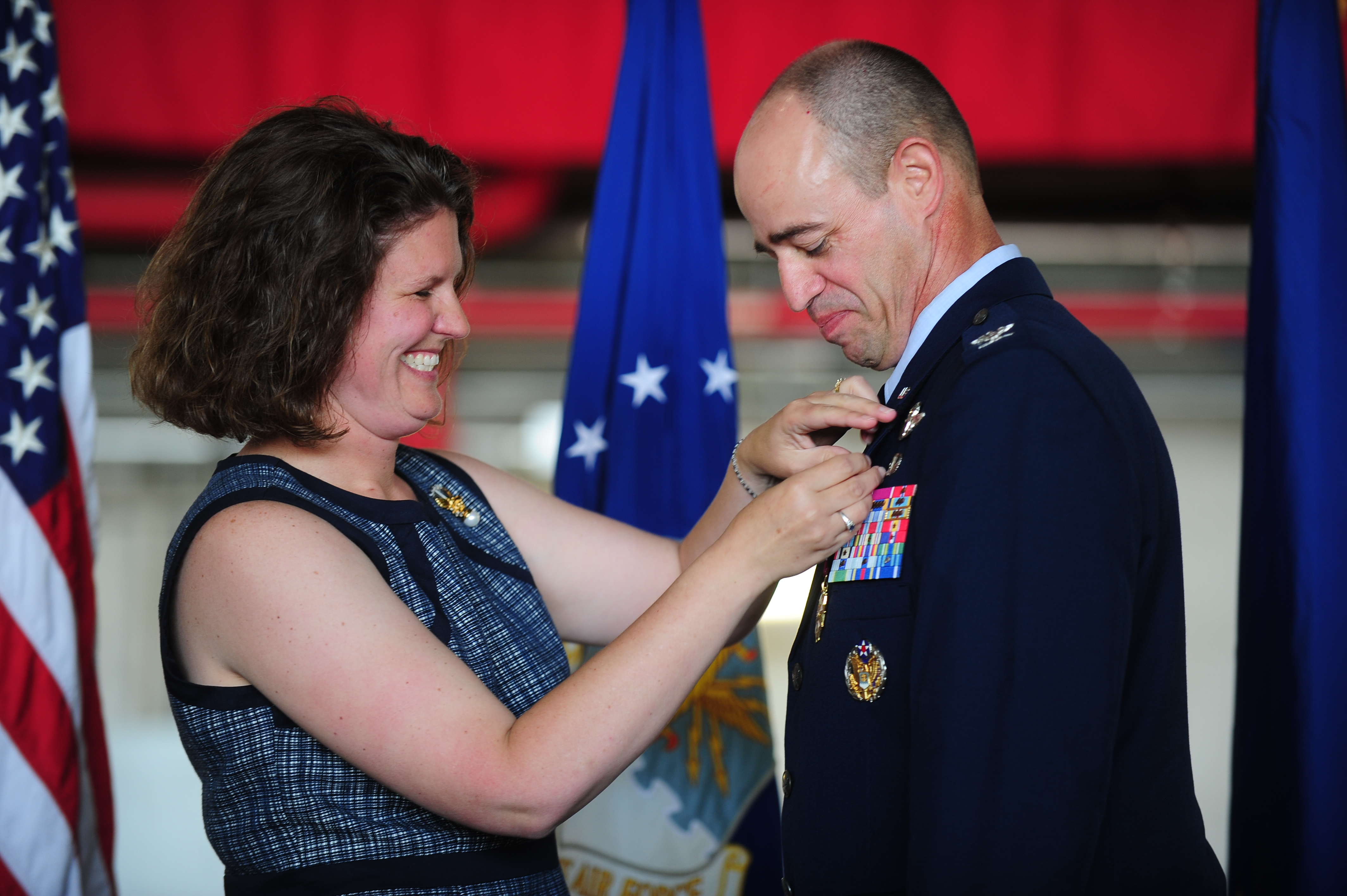 Photos erica gantt fastens an air force retirement pin onto her husband air force district of publicscrutiny Choice Image