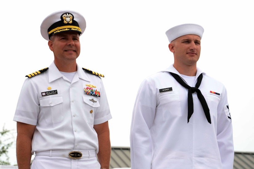 Captain John Fahs, Naval Nuclear Power Training Command commanding officer, stands with Petty Officer 3rd Class Joseph Wagner as he is recognized with the Hard Charger award at during the NNPTC  graduation ceremony of Power School class 1402 June 6, 2014, at Joint Base Charleston – Weapons Station, S.C. (US Navy photo/Petty Officer  2nd Class Jason Pastrick)