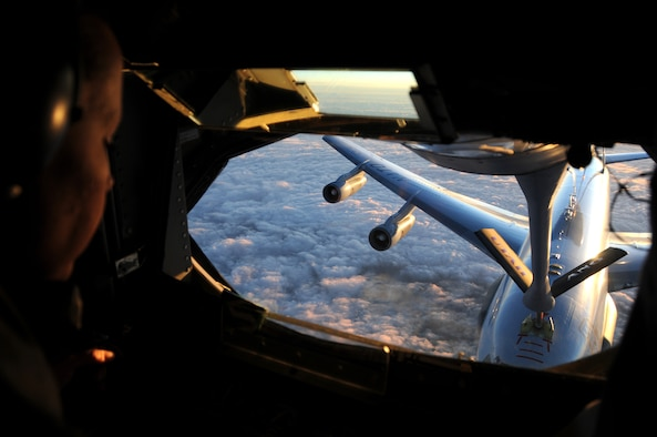 Staff Sgt. Patricia Rich, a boom operator with the 19st Air Refueling Squadron, trains NATO E-3A pilots in air refueling during a flight over Germany in May 2014. (Utah Air National Guard photo by Staff Sgt. Annie Edwards/RELEASED)