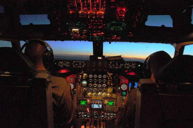 Maj. Jeremy Morrison and Maj. Zachery Love, pilots with the 191st Air Refueling Squadron, fly a KC-135R Stratotanker during a night training exercise over Germany in May 2014. (Utah Air National Guard photo by Staff Sgt. Annie Edwards/RELEASED)