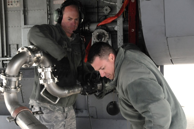Master Sgt. Tony Garr and Tech. Sgt. Cory Hardy, 151st Maintenance Group, refuel a KC-135R Stratotanker before a training flight at NATO Air Base Geilenkirchen, Germany, in May 2014. (Utah Air National Guard photo by Staff Sgt. Annie Edwards/RELEASED)