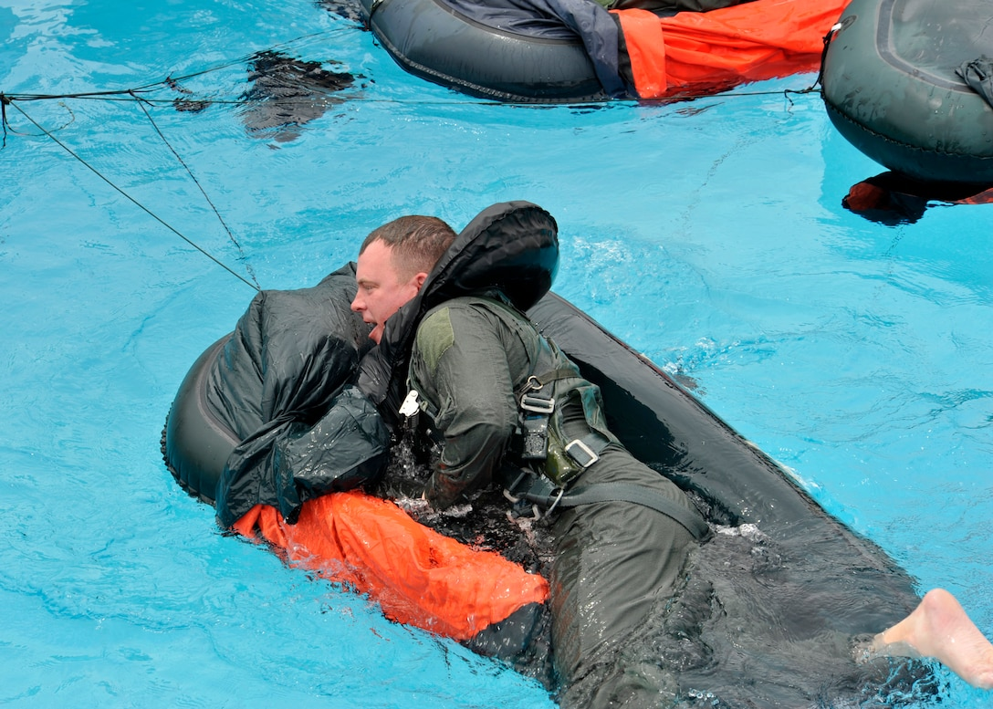 Maj. Brendan Shannon, 309th Fighter Squadron director of operations, climbs into a one-man raft. When a pilot ejects, survival equipment, including a life raft, is ejected with the seat and is inflated by the time the pilot lands in the water. (U.S. Air Force photo/Senior Airman Marcy Copeland)