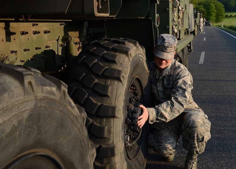 U.S. Air Force Senior Airman Robert Gordon, 606th Air Control Squadron power production apprentice, conducts a hot brake check on route to Powidz Air Base, Poland, June 3, 2014. There were three groups of vehicles that left Spangdahlem Air Base, Germany, convoying nearly 90 U.S. Airmen to Poland. The vehicles transported equipment to set up air-to-ground communication in support of Exercise EAGLE TALON and U.S. Aviation Detachment Rotation 14-3, both exercises that increase NATO interoperability. (U.S. Air Force photo by Airman 1st Class Kyle Gese/Released)