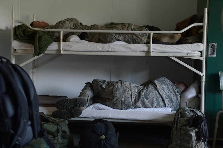 U.S. Air Force Airmen sleep at a Bundeswehr Army Post, Schwarzenborn, Germany, while they wait for convoy vehicle repairs from Spangdahlem Air Base, Germany, June 3, 2014. Airmen from the 606th Air Control Squadron convoyed to Poland to support NATO air assets from the United Kingdom, France, U.S. and Poland with ground-to-air communications during two military exercises. (U.S. Air Force photo by Airman 1st Class Kyle Gese/Released)