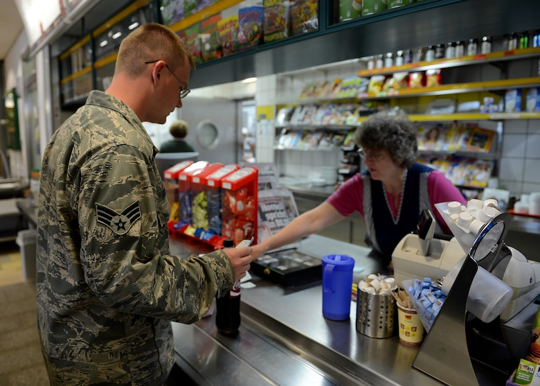 U.S. Air Force Robert Gordon, 606th Air Control Squadron power production apprentice, orders food during a stop at Schwarzenborn, Germany, June 3, 2014. The convoy vehicles experienced some mechanical issues that required support from Spangdahlem Air Base's vehicle maintenance personnel. The Bundeswehr, or German armed forces, hosted U.S. Airmen from Spangdahlem Air Base, Germany, while waiting for a replacement part before continuing to Powidz Air  Base, Poland, to provide air control to NATO air assets during various combined exercises. (U.S. Air Force photo by Airman 1st Class Kyle Gese/Released)