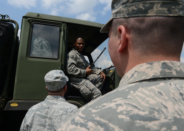 U.S. Air Force Senior Airman Bobby Gordon, 606th Air Control Squadron power production apprentice and U.S. Air Force Capt. Romaine Russell, 606th Air Control Squadron bravo convoy commander, gives instructions to U.S. Airmen during a stop in the second longest convoy in the history of the 606th ACS, June 2, 2014. Each vehicle in the convoy had at least two people, a driver and passenger, to safely drive long distances from Spangdahlem Air Base, Germany, to Powidz Air Base, Poland to provide air control support to NATO assets participating in Polish-led Exercise EAGLE TALON and U.S. Aviation Detachment Rotation 14-3. These training exercises aim to increase NATO partnership capacity for future real-world scenarios. (U.S. Air Force photo by Airman 1st Class Kyle Gese/Released)