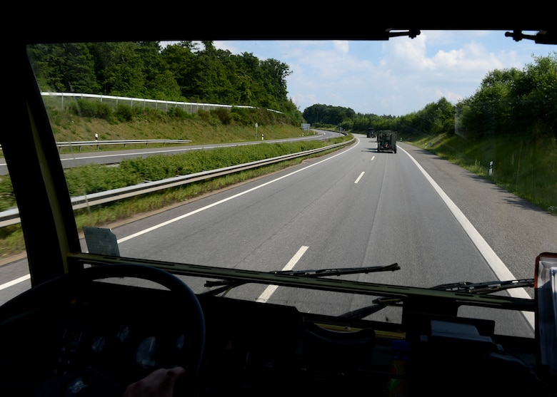 A U.S. Air Force convoy drives on the autobahn in Germany toward Poland to provide air control for NATO air assets participating in various military training events, June 2, 2014. The 606th Air Control Squadron, Spangdahlem Air Base, Germany, is supporting the Polish-led Exercise EAGLE TALON and U.S. Aviation Detachment Rotation 14-3. Poland and U.S. share a strong military partnership and train together to increase readiness in support for NATO operations. (U.S. Air Force photo by Airman 1st Class Kyle Gese/Released)