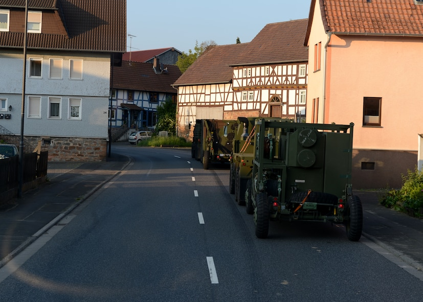 A U.S. Air Force convoy drives through a village on the route to Powidz Air Base, Poland, June 2, 2014. The 45 vehicles from the 606th Air Control Squadron of Spangdahlem Air Base, Germany, carried nearly 90 U.S. Airmen to provide ground-to-air communication to NATO air assets training during Poland's Exercise EAGLE TALON and U.S. Aviation Detachment Rotation 14-3. This was the second longest convoy in the history of 606th ACS. (U.S. Air Force photo by Airman 1st Class Kyle Gese/Released)