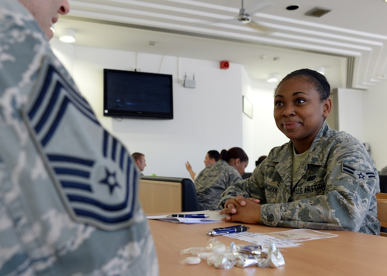 U.S. Air Force Airman 1st Class Jessica Cunningham, 52nd Force Support Squadron Mosel Dining Hall staff member from San Antonio, speaks with U.S. Air Force Chief Master Sgt. Art Roy, 52nd Civil Engineer Squadron Operations Flight superintendent from Gorham, N.H., during the inaugural FSS speed-mentoring event June 6, 2014, in the dining facility at Spangdahlem Air Base, Germany. Roy has earned the highest enlisted rank for the U.S. Air Force and volunteered his time to mentor junior Airmen on how to be successful as a service member. (U.S. Air Force photo by Staff Sgt. Daryl Knee/Released)