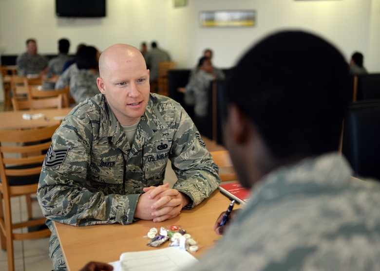 U.S. Air Force Tech. Sgt. Mike Baker, Pitsenbarger Airman Leadership School instructor from Vancouver, Wash., talks with U.S. Air Force Airman 1st Class Zackery Tookes, 52nd Force Support Squadron Mosel Dining Hall staff member from Atlanta, during the inaugural FSS speed-mentoring event in the dining facility at Spangdahlem Air Base, Germany, June 6, 2014. NCOs and senior NCOs from the force support squadron volunteered to act as a guide or mentor to the attending junior Airmen. The participants would sit with mentors for three minutes to gauge compatibility before moving on to the next potential mentor. (U.S. Air Force photo by Staff Sgt. Daryl Knee/Released)