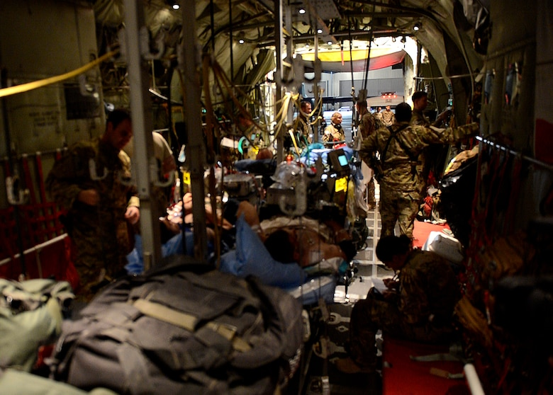 U.S. Air Force Airmen from the 455th Expeditionary Aeromedical Evacuation Squadron prepare to unload patients at Bagram Airfield, Afghanistan, May 29, 2014. (U.S. Air Force photo by Staff Sgt. Evelyn Chavez)