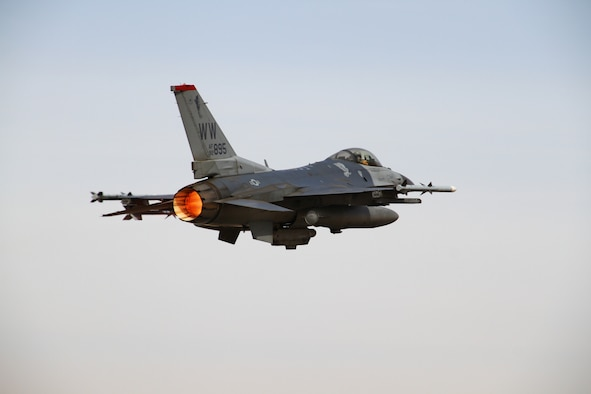 An F-16 Fighting Falcon from the 13th Fighter Squadron at Misawa Air Base, Japan, takes to the skies over an air base in northern Jordan May 29, 2014, during Exercise Eager Lion. Throughout the two-week exercise, service members from more than 20 partner nations joined together at locations throughout Jordan to build functional capacity, enhance readiness and promote interoperability. (U.S. Air Force photo by Staff Sgt. Tyler McLain)