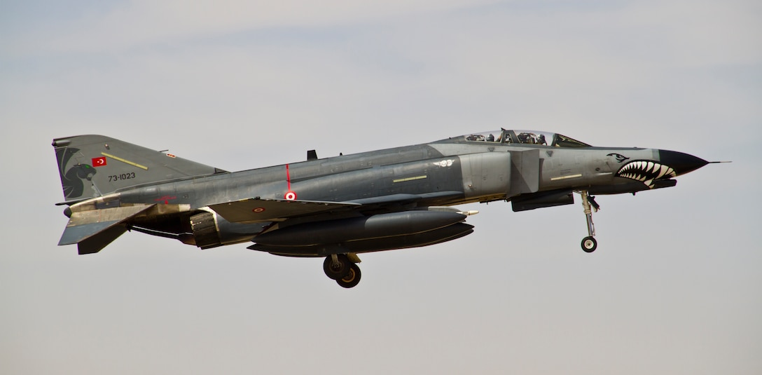 An F-4 Phantom II from the Turkish Air Force flies during a mission at Exercise Eager Lion May 29, 2014, over an air base in northern Jordan. Soldiers, Sailors, Airmen and Marines from more than 20 partner nations came together for two weeks to enhance their interoperability while participating in air-, land- and sea-based scenarios. (U.S. Air Force photo by Staff Sgt. Tyler McLain)