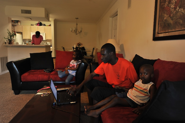 Senegal air force Maj. Papa Dieumb Gueye studies on a Sunday afternoon as his family relaxes. Gueye attends Air Command and Staff College at the Air University where he completes approximately four hours of homework a day. His family is active in the Maxwell Air Force Base community, with his children attending the child development center. His wife meets with other international officer's spouses that she met through base programs. (U.S. Air Force photo/Staff Sgt. Natasha Stannard)